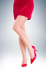 Lower half of girl in red skirt and heels