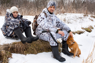 hunter with his son and dog during the rest