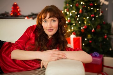 Beautiful redhead lying on the couch at christmas