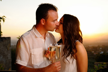 Toast young couple kissing at sunset