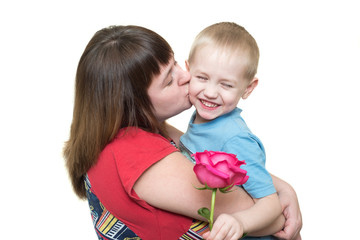 Mom kisses her son with a rose isolated on a white background