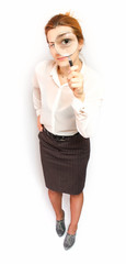 Young business woman magnifying