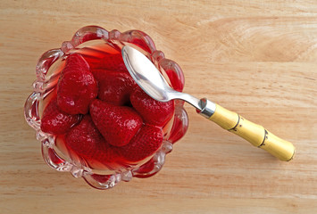 Strawberries in a bowl with spoon
