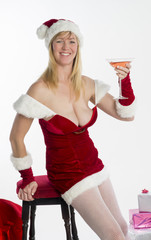 Woman in sexy Santa costume with fizzy drink