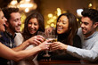 Group Of Friends Enjoying Evening Drinks In Bar - 74890075