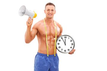 Shirtless man holding a clock and a megaphone