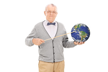 Teacher pointing on the earth with a stick