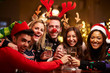 Group Of Friends Enjoying Christmas Drinks In Bar - 74890468