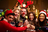Group Of Friends Enjoying Christmas Drinks In Bar - 74890468