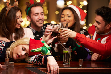 Woman Passed Out On Bar During Christmas Drinks With Friends