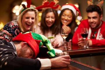 Man Passed Out On Bar During Christmas Drinks With Friends