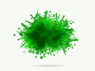 Green color splash on grey background.