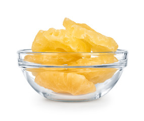 Dried pineapple in a glass bowl isolated on white background