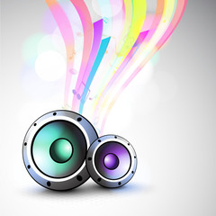 Musical instrument speakers with colorful waves.