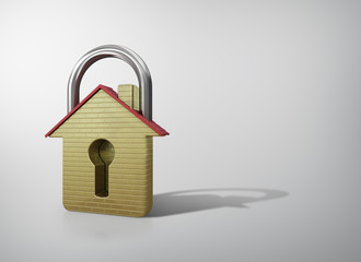 House in the shape of a gold padlock. Concept of save.