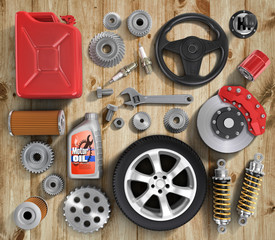 Set of parts of car on wood background.