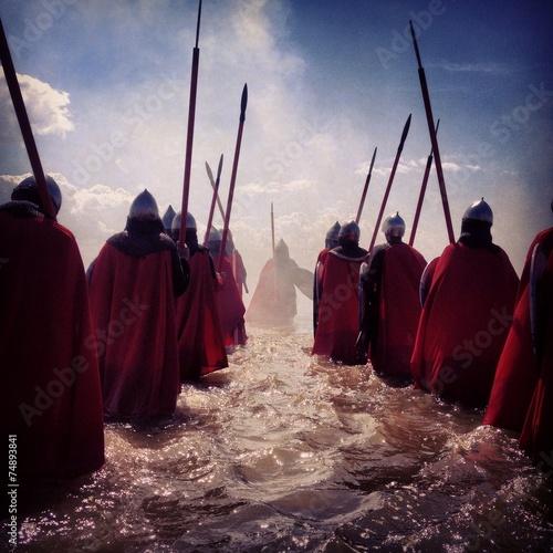 wariors walking in the water
