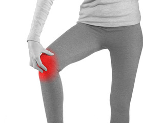 Sports injury - woman having pain in his knee making massage.