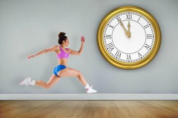 Composite image of fit brunette running