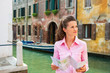 Young woman with map in venice, italy