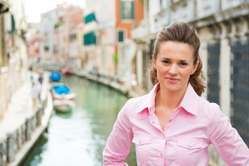 Young woman standing on bridge in venice, italy