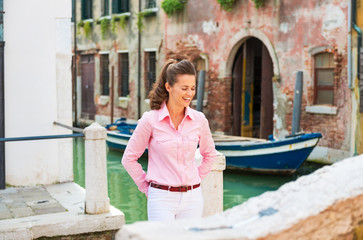 Portrait of happy young woman in venice, italy