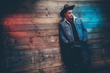 Winter cowboy jeans fashion man. Wearing brown hat, jeans jacket