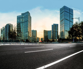 Asphalt road High way with city background