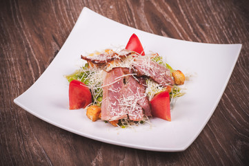 cesar salad with bacon, tomato, croutons and cheese