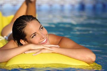 Girl enjoying summer vacations on a mattress