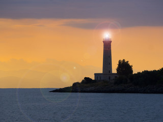 Lighthouse at sunset in Gytheio, Greece