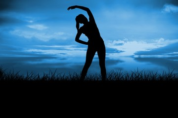 Composite image of fit brunette stretching and smiling