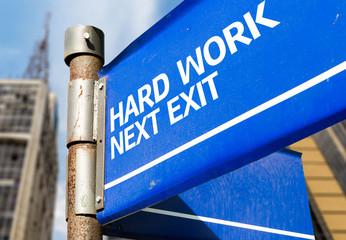 Hard Work Next Exit blue road sign