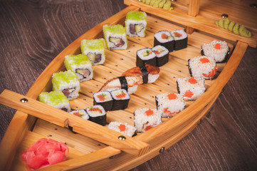 sushi roll set on boat plate