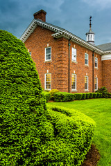 Storm clouds over bushes and a building at the Lutheran Seminary