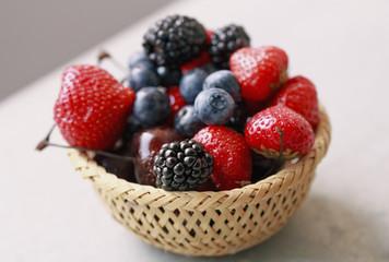 Fresh summer berries in wood basket