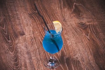blue alcohol cocktail in high glass