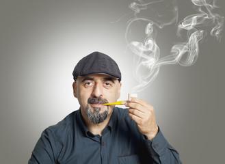 The man smokes a pipe