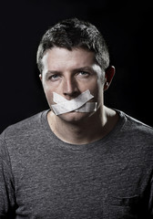 attractive man mouth shut on tape freedom of speech concept