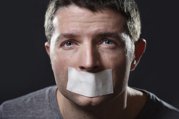 man lips sealed on adhesive tape freedom of speech concept