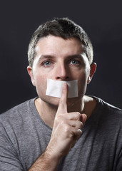 man mouth tape sealed freedom of expression concept