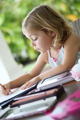 Portrait of little girl making drawings