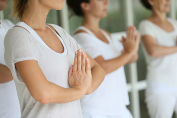 Closeup of hands put together on meditation exercise