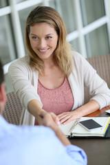 Businesswoman giving handshake to new business partner