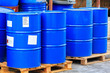 Big blue barrels on wooden pallets - 74899226