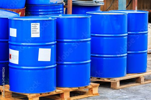 Big blue barrels on wooden pallets - 74899226