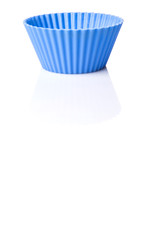 Blue silicone baking cups over white background