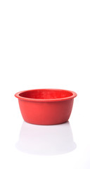 Red silicone muffin baking cup over white background