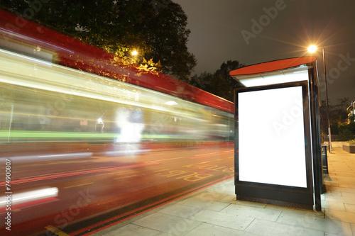 Blank billboard in bus stop - 74900807