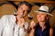 Leinwanddruck Bild - Tourism - Couple tasting wine in a cellar
